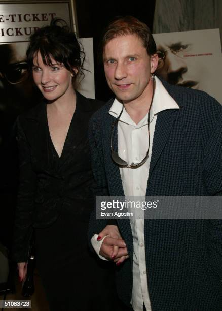 Actor Simon McBurney and his wife arrive at the world premiere for 'The Manchurian Candidate' on July 19 2004 at the Beekman Theatre in New York City