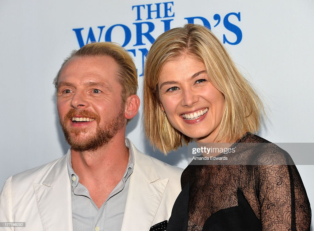 Actor Simon Pegg (L) and actress Rosamund Pike arrive at the Los Angeles premiere of 'The World's End' at ArcLight Cinemas Cinerama Dome on August 21, 2013 in Hollywood, California.