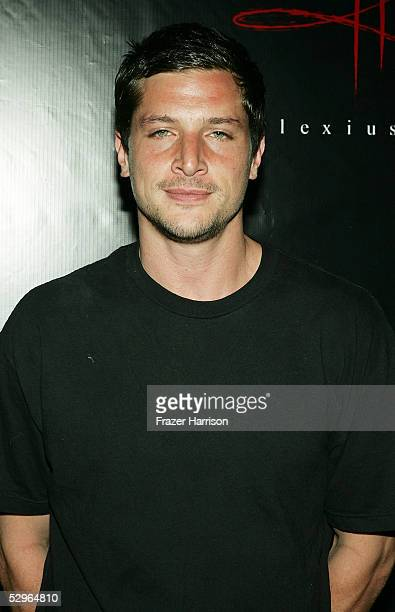Actor Simon Rex attends the Christian Audigier Fashion Show launching Ed Hardy Vintage Tattoo Wear held in Hollywood on May 21,2005 Los Angeles...