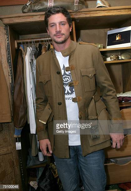 Actor Simon Rex poses with the Latino Royalty display at the Gibson Guitar and Entertainment Tonight celebrity hospitality lodge in the Miner's Club...