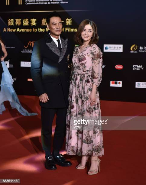 Actor Simon Yam and singer and actress Charlene Choi arrive on the red carpet of the 2nd International Film Festival Awards Ceremony on December 8...