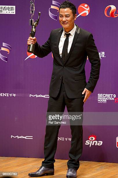 Actor Simon Yam poses backstage with his award for Best Actor for his performance in the movie Echoes of the Rainbow at the 29th Hong Kong Film...