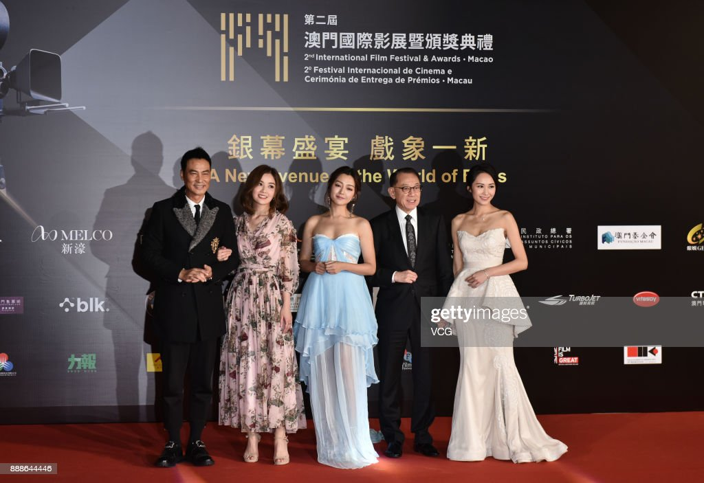 Actor Simon Yam, singer and actress Charlene Choi, actress Michelle Wai, Chairman of Emperor Group Albert Yeung and actress Kathy Tong arrive on the red carpet of the 2nd International Film Festival & Awards Ceremony on December 8, 2017 in Macao, China.