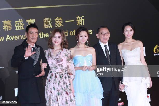Actor Simon Yam singer and actress Charlene Choi actress Michelle Wai Chairman of Emperor Group Albert Yeung and actress Kathy Tong arrive on the red...