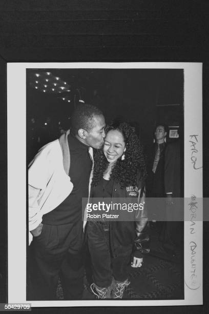 Actor singer Ben Vereen kissing the cheek of his daughter Karon at the premiere of the film Malcolm X