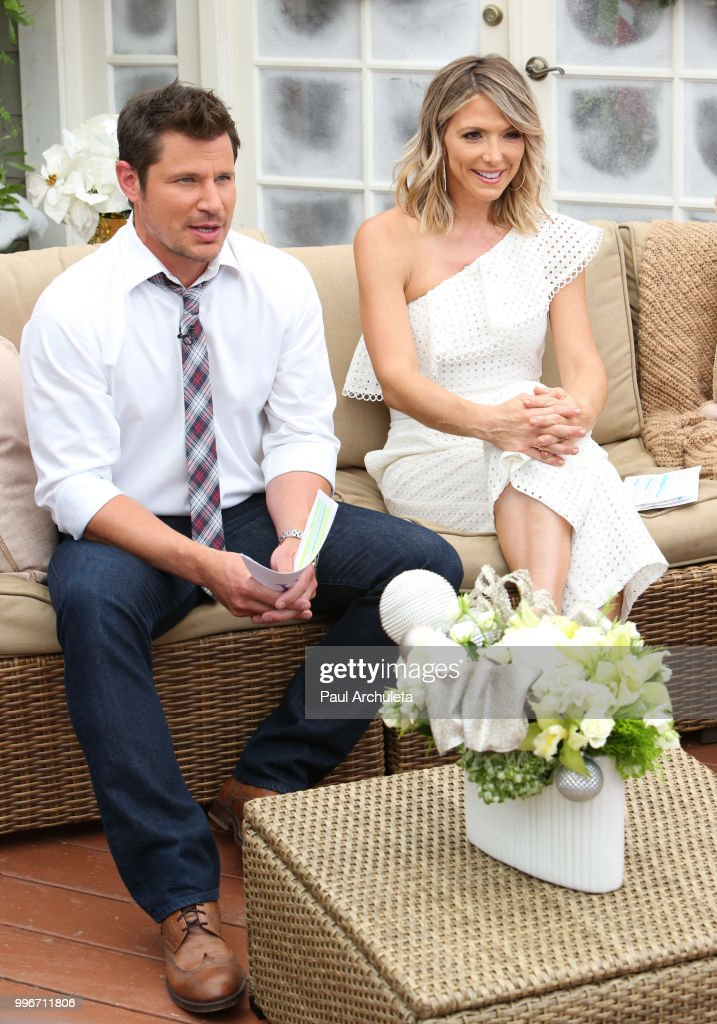 Actor / Singer Nick Lachey (L) and TV Host Debbie Matenopoulos (R) visit Hallmark's 'Home & Family' celebrating 'Christmas In July' at Universal Studios Hollywood on July 11, 2018 in Universal City, California.