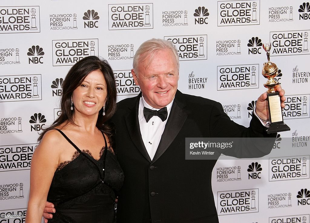 Actor Sir Anthony Hopkins (R) with his Cecil B. DeMille Award and his wife Stella Arroyave pose backstage during 63rd Annual Golden Globe Awards at the Beverly Hilton on January 16, 2006 in Beverly Hills, California.