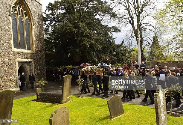 Actor Sir John Mills' coffin is carried inside the church of St Mary The Virgin for his funeral service 27 April 2005 in Denham AFP PHOTO/Max Nash