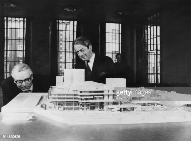 Actor Sir Laurence Olivier director of the National Theatre and architect Denys Lasdun view a model of the proposed theatre on show in London 29th...