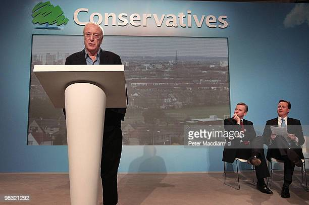 Actor Sir Michael Caine helps launch a 'National Citizens Service' watched by Conservative party leader David Cameron and shadow education spokeman...
