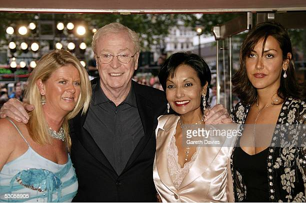OUT*** Actor Sir Michael Caine his wife Shakira and daughters Nikki and Natasha arrive at the European premiere of Batman Begins at the Odeon...