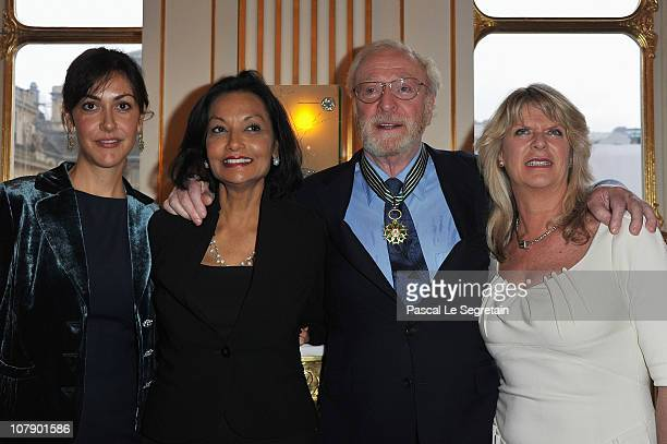 Actor Sir Michael Caine poses with daughters Natasha and Dominique and his wife Shakira after being awarded Commandeur des arts et des lettres by...