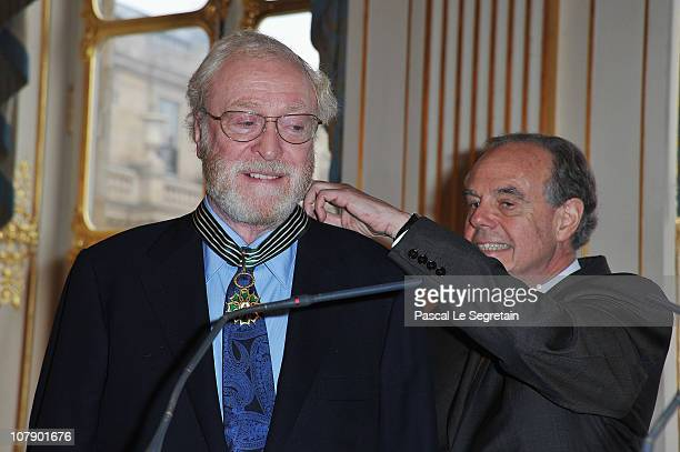 Actor Sir Michael Caine smiles as he is awarded Commandeur des arts et des lettres by French Culture Minister Frederic Mitterrand at Ministere de la...