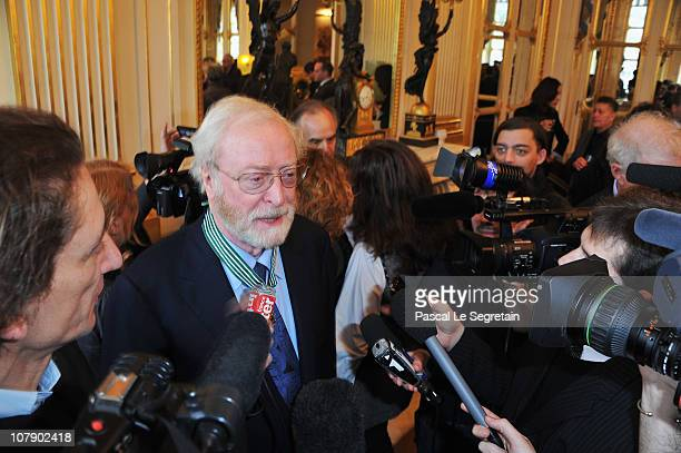 Actor Sir Michael Caine speaks to the media after being awarded Commandeur des arts et des lettres by French Culture Minister Frederic Mitterrand at...