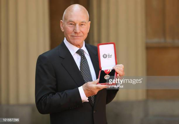 Actor Sir Patrick Stewart poses with his award after he was Knighted by Britain's Queen Elizabeth II at Buckingham PalaceJune 02 2010 in London...