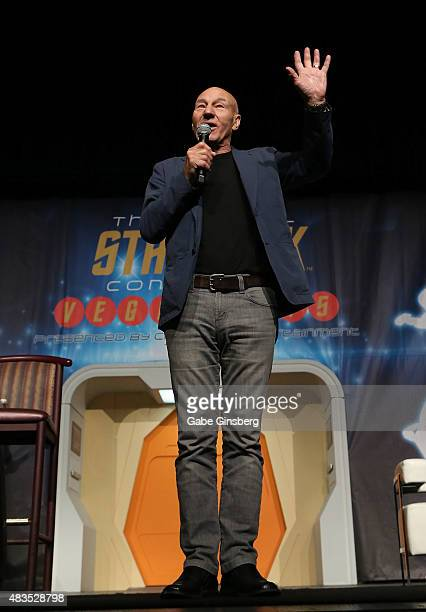 Actor Sir Patrick Stewart waves to the audience as he speaks during the 14th annual official Star Trek convention at the Rio Hotel Casino on August 9...
