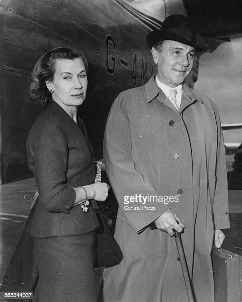 Actor Sir Ralph Richardson and his wife Lady Richardson arriving home after a trip to Paris at London Airport May 12th 1956