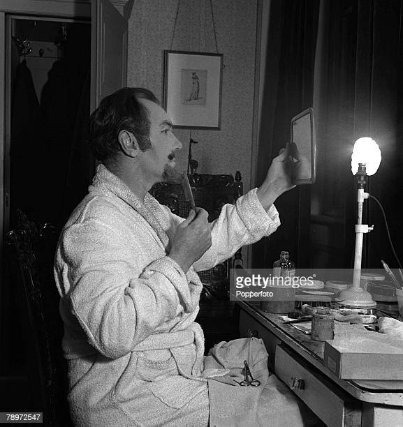 Actor Sir Ralph Richardson applying his make up at the Haymarket Theatre London before going on for the first night of 'The Heiress' 1949