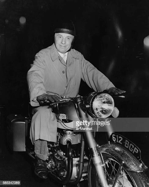 Actor Sir Ralph Richardson riding his new motorcycle near his home in Maida Vale London November 21st 1960
