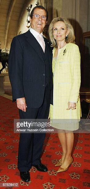 Actor Sir Roger Moore and his wife Kiki arrive at a ceremony for the Help The Aged Living Legends Awards hosted by HRH Queen Elizabeth II at Windsor...