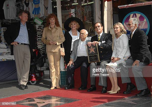 Actor Sir Roger Moore and wife Christina 'Kiki' Tholstrup pose with actresses Stephanie Powers Ruta Lee Johnny Grant and actor David Hedison at the...