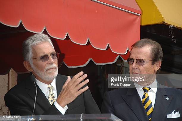 Actor Sir Roger Moore with actor David Hedison at the star ceremony honoring Moore on the Hollywood Walk of Fame