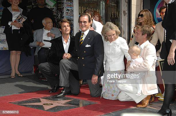 """Actor Sir Roger Moore with wife Christina """"Kiki"""" Tholstrup at his side and family pose at the star ceremony honoring him on the Hollywood Walk of..."""