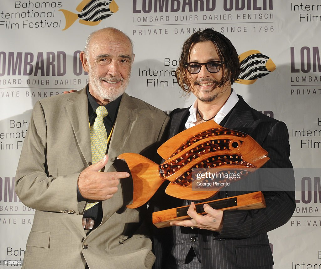 Actor Sir Sean Connery presents actor Johnny Depp with the prestigious Career Achievement Award at the 6th Annual Bahamas Film Festival special tribute and presentation at the Balmoral Club on December 13, 2009 in Nassau, Bahamas.