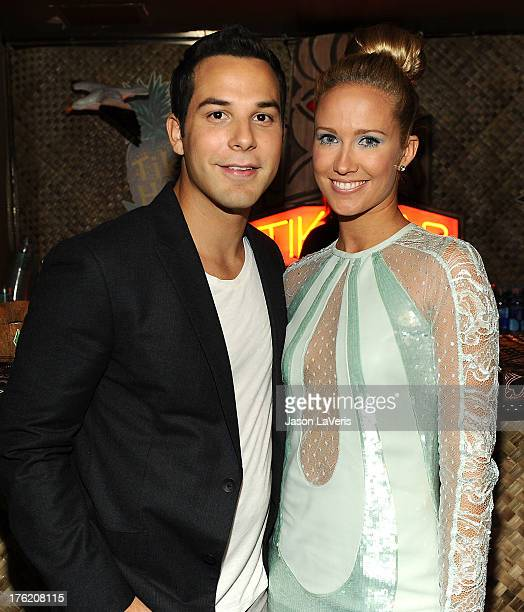 Actor Skylar Astin and actress Anna Camp pose in the green room at the 2013 Teen Choice Awards at Gibson Amphitheatre on August 11 2013 in Universal...