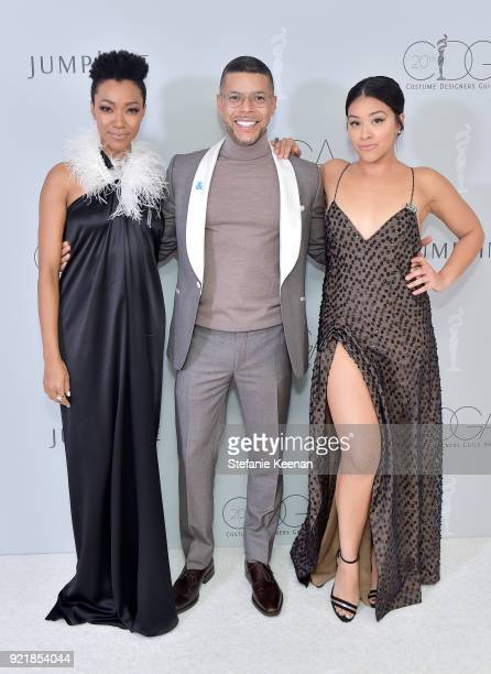 Actor Sonequa MartinGreen actor Wilson Cruz and host Gina Rodriguez attend the Costume Designers Guild Awards at The Beverly Hilton Hotel on February...
