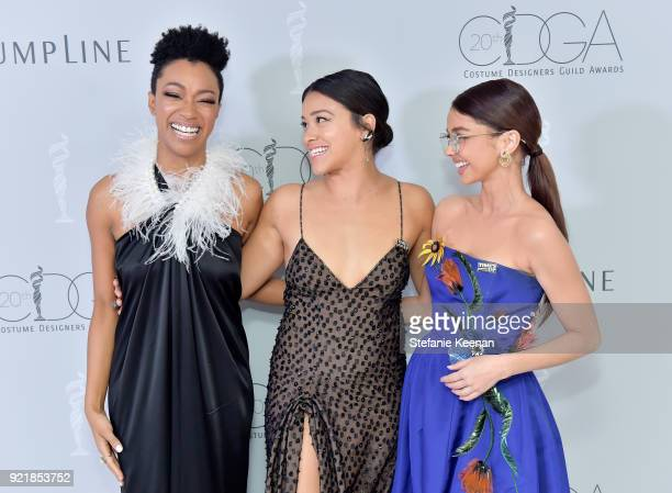 Actor Sonequa MartinGreen host Gina Rodriguez and actor Sarah Hyland attend the Costume Designers Guild Awards at The Beverly Hilton Hotel on...