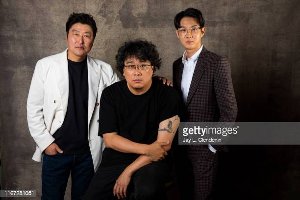 Actor Song Kang Ho director Bong Joonho and actor Choi Wooshik from 'Parasite' are photographed for Los Angeles Times on September 7 2019 at the...