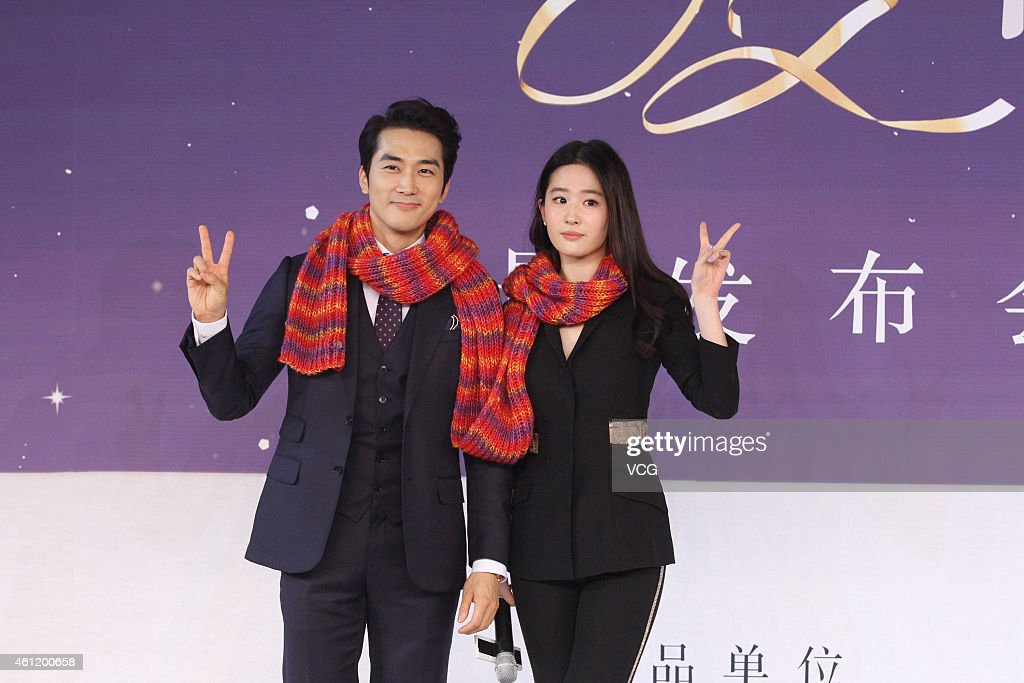 Actor Song Seung Heon and actress Liu Yifei attend director John H. Lee's film 'The Third Love' press conference on January 8, 2015 in Beijing, China.