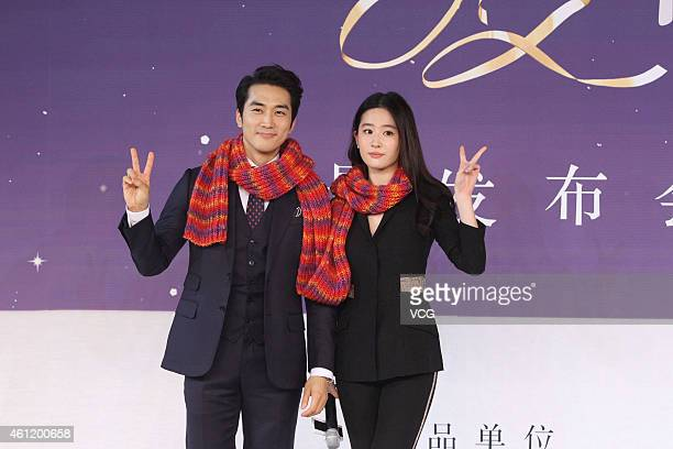 Actor Song Seung Heon and actress Liu Yifei attend director John H Lee's film 'The Third Love' press conference on January 8 2015 in Beijing China