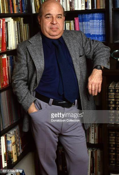 Actor Sorrell Booke poses for a portrait session in his library at home in 1985 in Los Angeles California