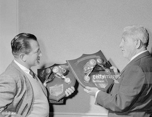 """Actor Spencer Tracey and producer director Edward Dmytryk admire their Silver Spurs awards, the """"Oscars"""" of western movies. The awards are presented..."""