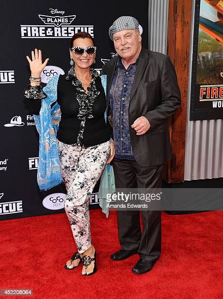 Actor Stacy Keach and his wife Malgosia Tomassi arrive at the Los Angeles premiere of Disney's Planes Fire Rescue at the El Capitan Theatre on July...