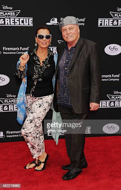Actor Stacy Keach and wife Malgosia Tomassi arrive at the Los Angeles premiere of Disney's 'Planes Fire Rescue' at the El Capitan Theatre on July 15...