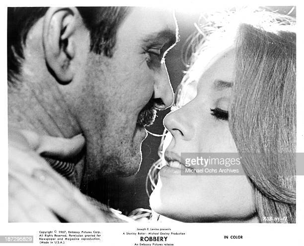 Actor Stanley Baker and actress Joanna Pettet on set of the Embassy Pictures movie Robbery in 1967