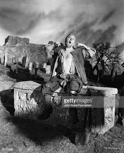 Actor Stanley Holloway as the gravedigger in Hamlet a Twin Cities/Pilgrim Pictures production directed by Laurence Olivier