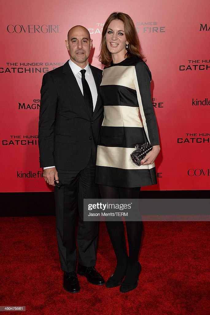 Actor Stanley Tucci (L) and Felicity Blunt arrive at the premiere of Lionsgate's 'The Hunger Games: Catching Fire' at Nokia Theatre L.A. Live on November 18, 2013 in Los Angeles, California.