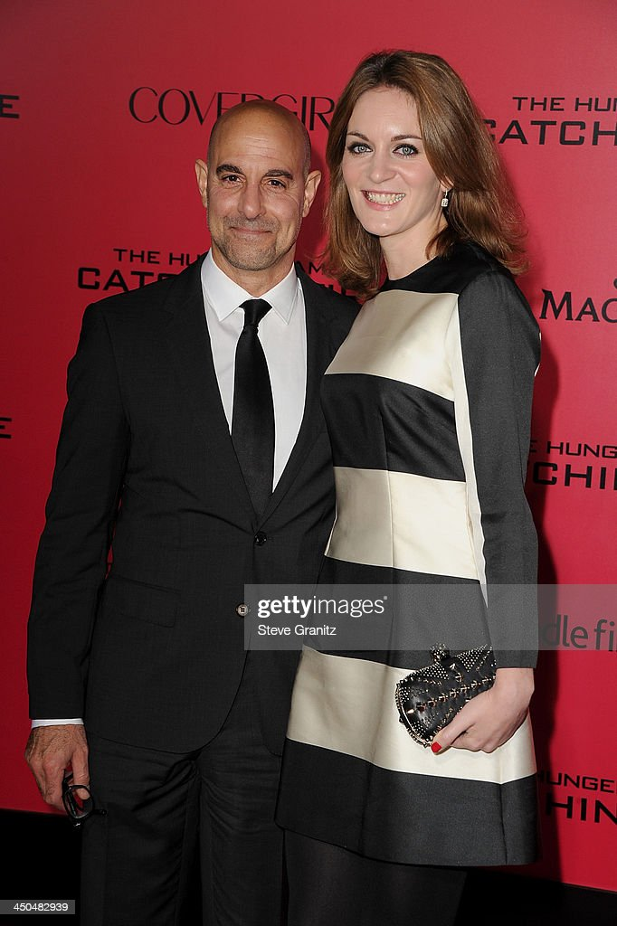 Actor Stanley Tucci and Felicity Blunt arrives at the Los Angeles premiere of 'The Hunger Games: Catching Fire' at Nokia Theatre L.A. Live on November 18, 2013 in Los Angeles, California.