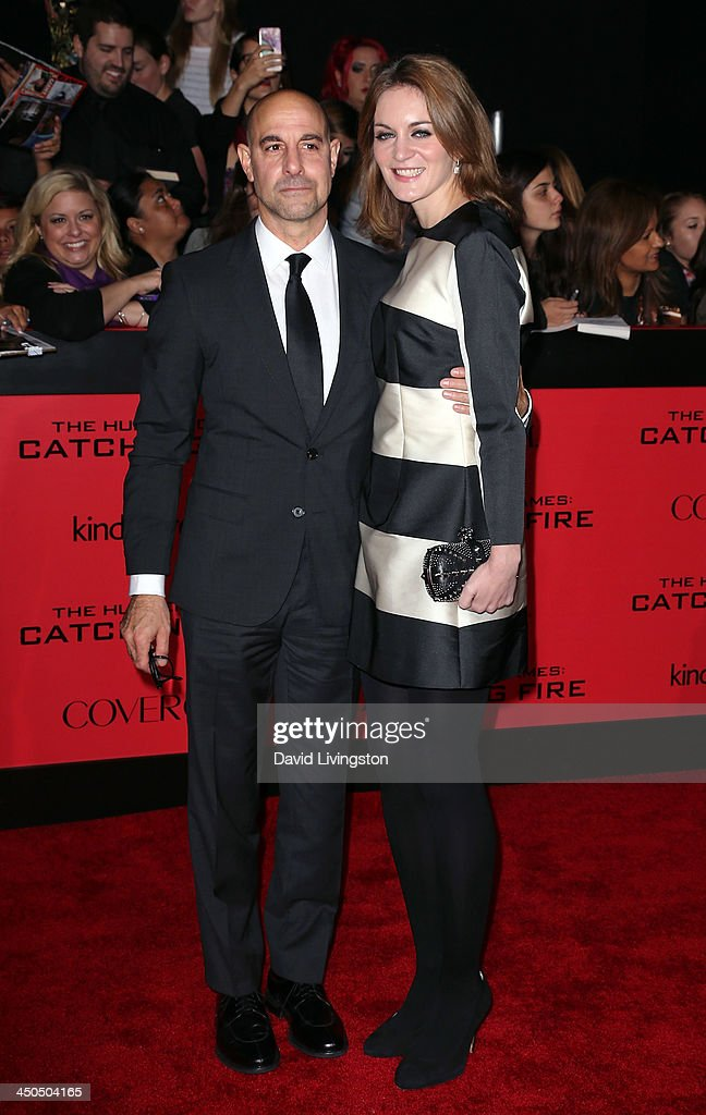 Actor Stanley Tucci (L) and wife Felicity Blunt attend the premiere of Lionsgate's 'The Hunger Games: Catching Fire' at Nokia Theatre L.A. Live on November 18, 2013 in Los Angeles, California.