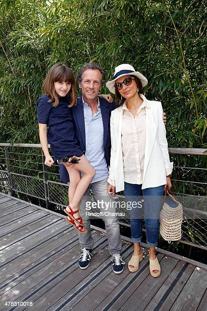 Actor Stepahne Freiss with his wife Ursula and his daughter Bianca attend the French Tennis Open 2015 at Roland Garros on May 30 2015 in Paris France