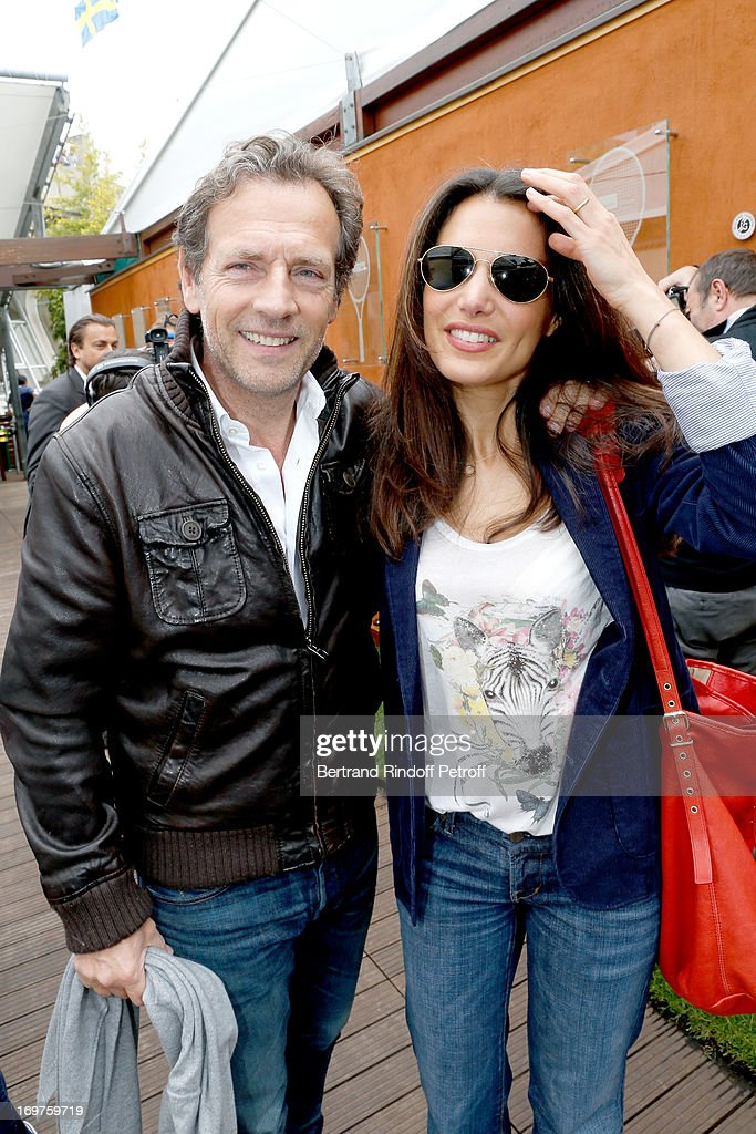 Actor Stephane Freiss and his wife Ursula attend Roland Garros Tennis French Open 2013 - Day 7 on June 1, 2013 in Paris, France.
