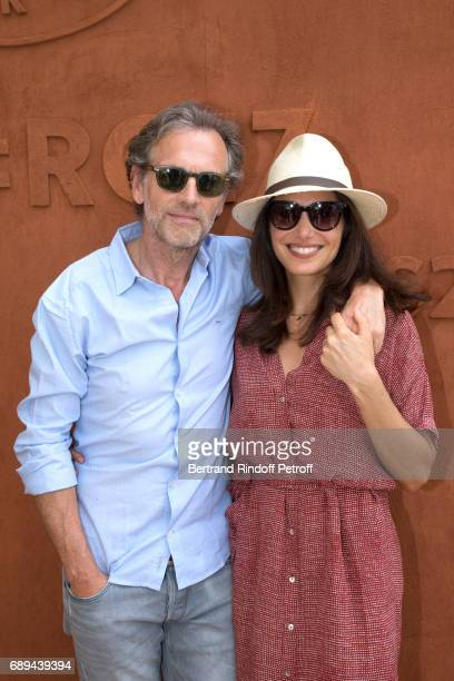 Actor Stephane Freiss and his wife Ursula attend the 2017 French Tennis Open Day One at Roland Garros on May 28 2017 in Paris France