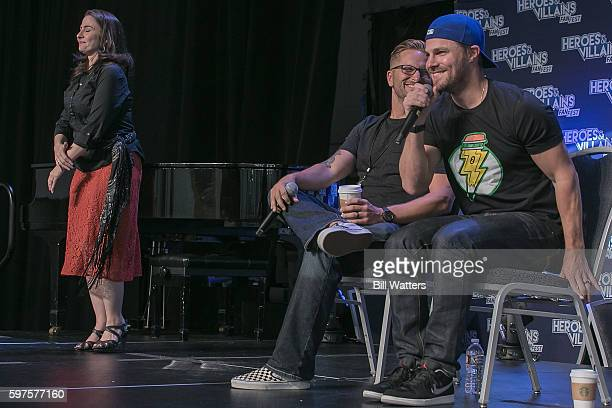 Actor Stephen Amell and Heroes and Villains Owner James Frazier attend the Stephen Amell spotlight panel during Heroes and Villains Fan Fest at San...