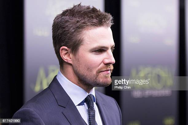 Actor Stephen Amell arrives on the green carpet for the celebration of the 100th Episode of CW's Arrow at the Fairmont Pacific Rim Hotel on October...