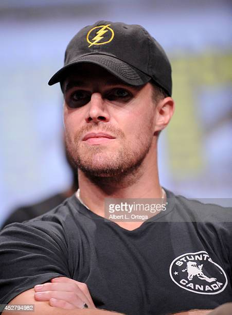 Actor Stephen Amell attends Warner Bros Television DC Entertainment world premiere presentation during ComicCon International 2014 at San Diego...