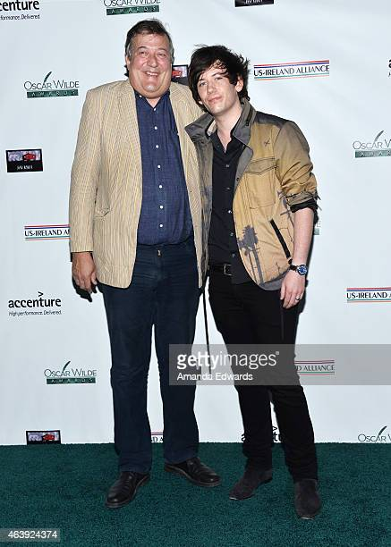 Actor Stephen Fry and his husband Elliott Spencer arrive at the USIreland Alliance PreAcademy Awards Honors event at Bad Robot on February 19 2015 in...